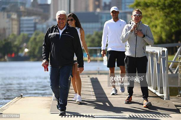Father Sebastian Nadal girlfriend Xisca Perello and Rafael Nadal of Spain relax as they walk along the Yarra River ahead of the 2017 Australian Open...