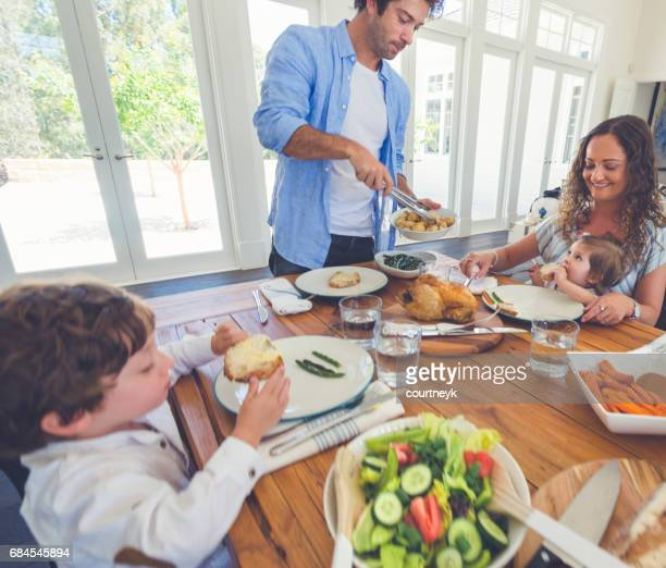 Father serving food to his family.