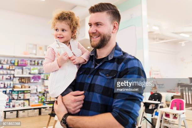 "father shopping with daughter in a children store. - ""martine doucet"" or martinedoucet stock pictures, royalty-free photos & images"