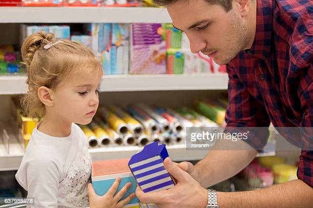 Father shopping with daughter