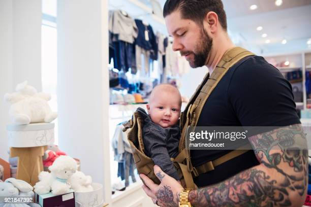 Father shopping with young baby in a children store.