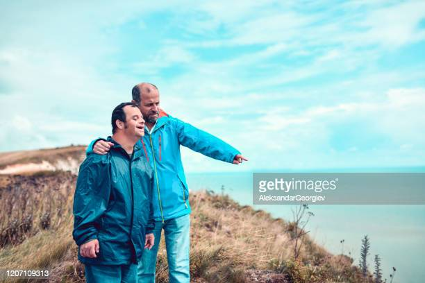 father showing son with disability a beautiful sight - community care stock pictures, royalty-free photos & images