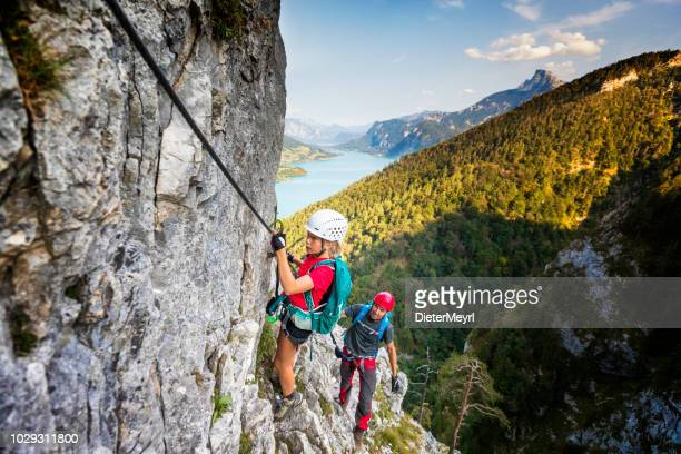 father shows daughter climbing in the alps - upper austria stock pictures, royalty-free photos & images