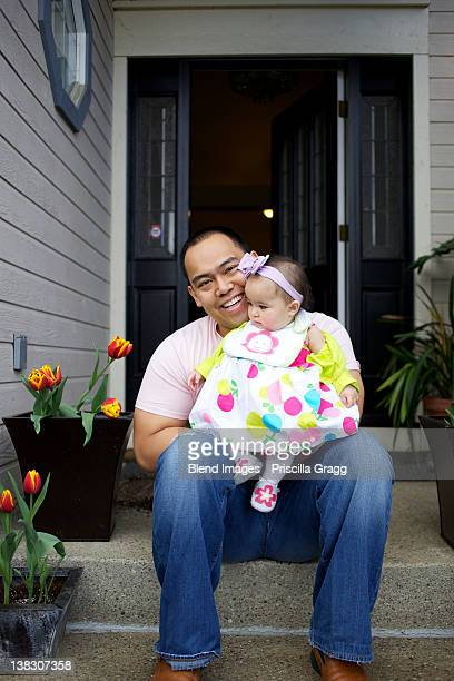 father sitting on front stoop with baby girl - concord california stock pictures, royalty-free photos & images