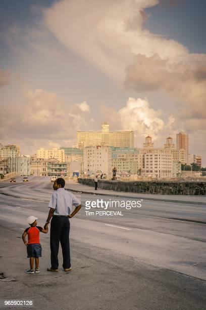 Father Son dawn light over the Malecon Havana