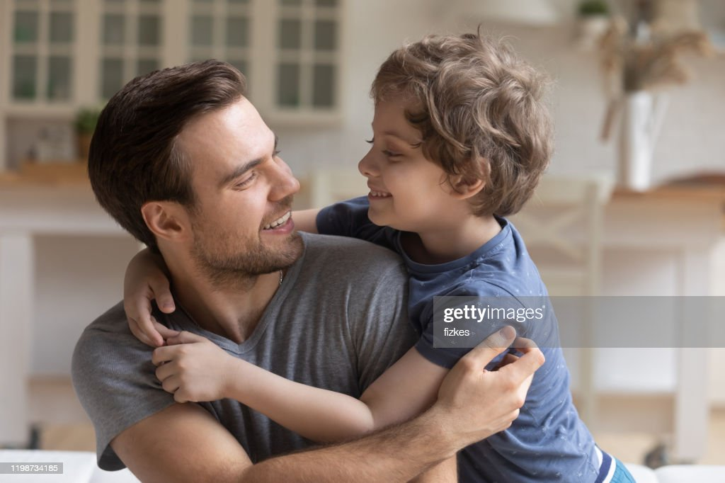 Father son having fun playing enjoy funny activities at home : Stock Photo