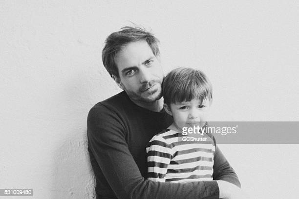 Father & Son looking at the camera