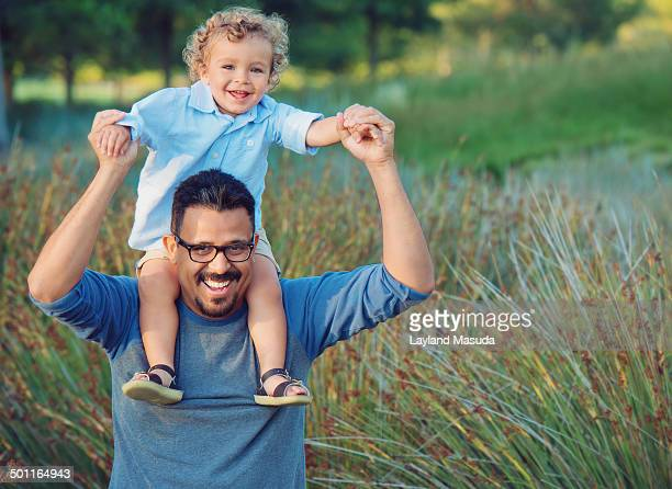 father son piggyback fun - irvine california stock pictures, royalty-free photos & images