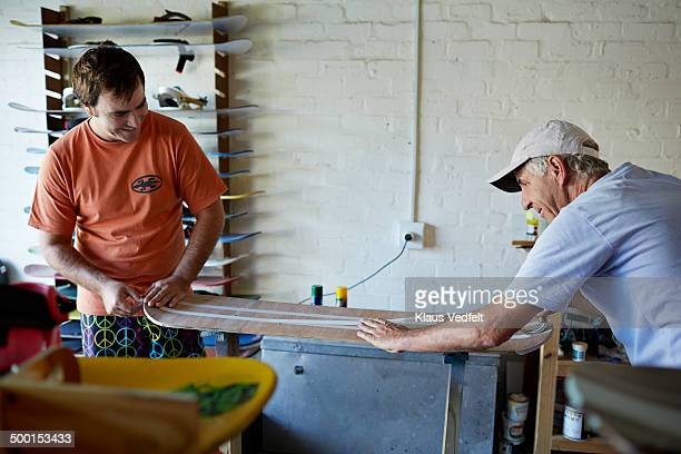 Father & son preparing a paintjob on a sandboard