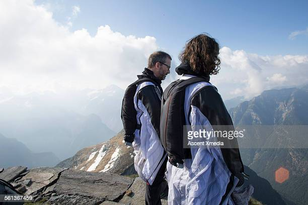 Father & son wingsuit fliers look at descent route