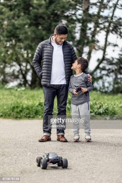 father son with rc car - remote control car games stock pictures, royalty-free photos & images