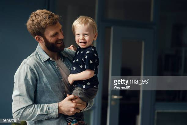 father spending time with his son at home - baby human age stock pictures, royalty-free photos & images