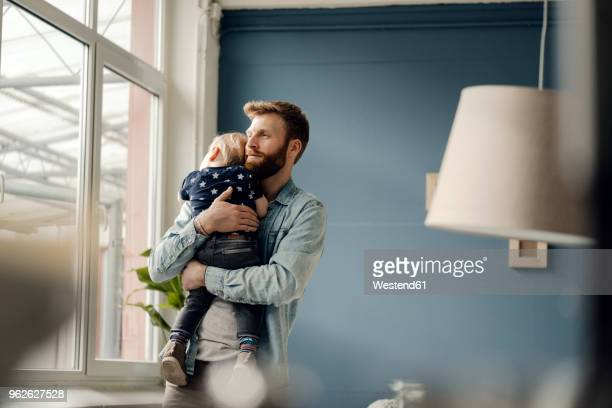 father spending time with his son at home - hygge stock pictures, royalty-free photos & images