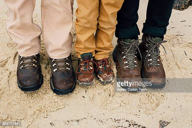 father standing with two children, focus on feet - hiking boot stock pictures, royalty-free photos & images