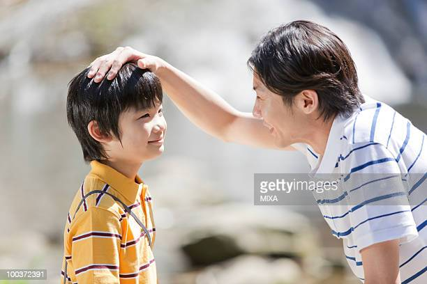 Father Stroking Son's Head
