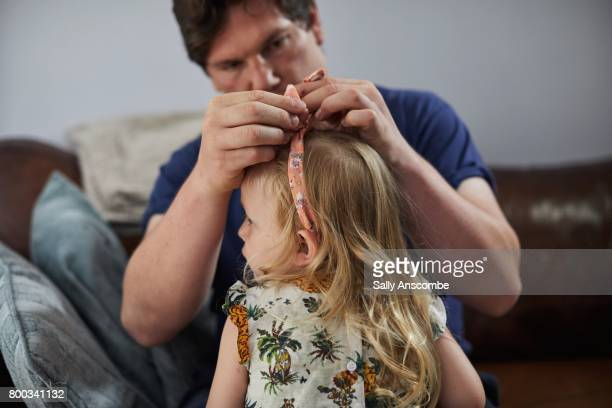 Father styling child hair