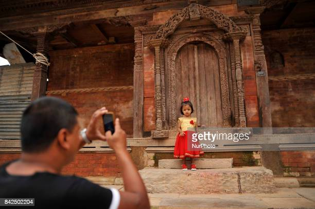 A father take pictures of her daughter impersonate as a Kumari or living Goddess during celebration of Kumari puja at Basantapur Durbar Square...