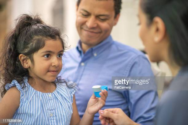 father takes daughter with asthma to see the doctor - asthma stock pictures, royalty-free photos & images