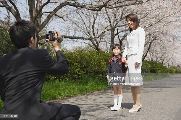 father taking a family photograph on road - free up skirt pics stock photos and pictures