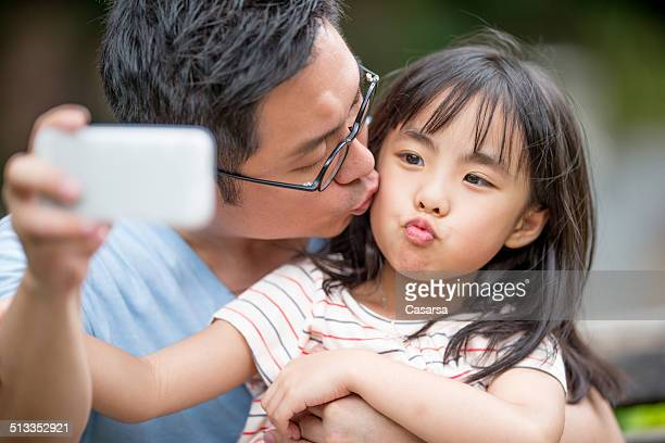 Father taking a selfie with a daughter