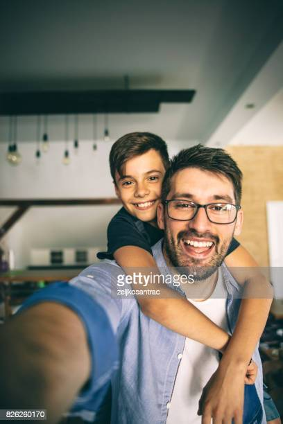 father taking a selfie with his son - selfie stock pictures, royalty-free photos & images