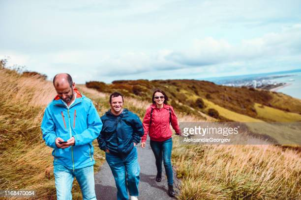 father taking a walk with daughter and disabled son - community care stock pictures, royalty-free photos & images