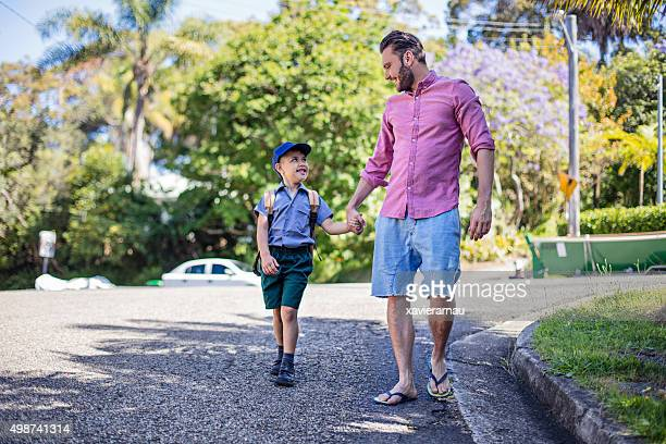 Father taking his son to school