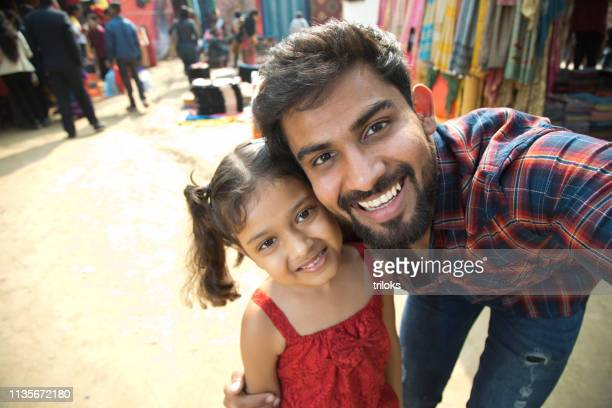 father taking selfie with daughter - indian culture stock pictures, royalty-free photos & images