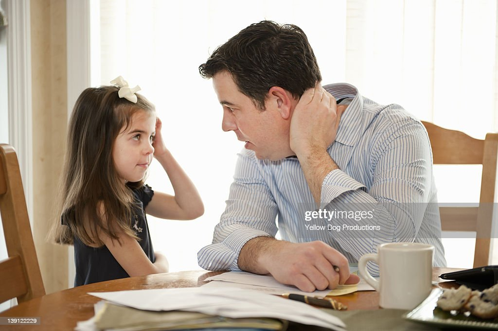 Father talking to Daughter While Working : Stock Photo