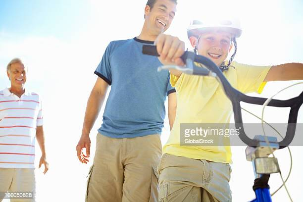 Father teaches his son to ride a bicycle