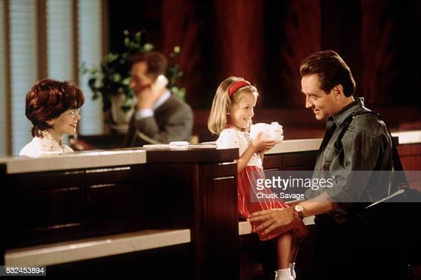 Father teaching his daughter to deposit her savings