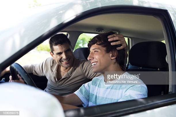 father teaching his son to drive - son stock pictures, royalty-free photos & images