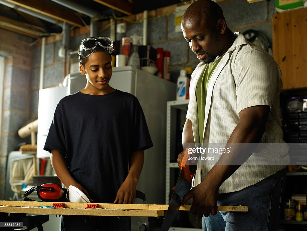 Father teaching Son carpentry skills : Stock Photo