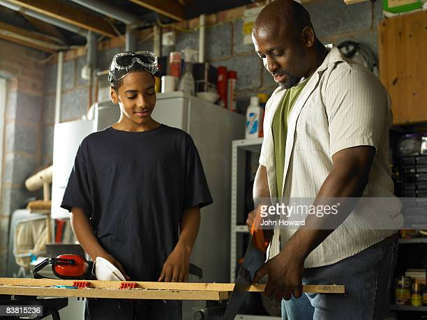 Father teaching Son carpentry skills