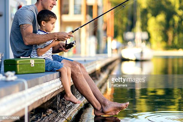 father teaching son how to fish - houseboat stock pictures, royalty-free photos & images