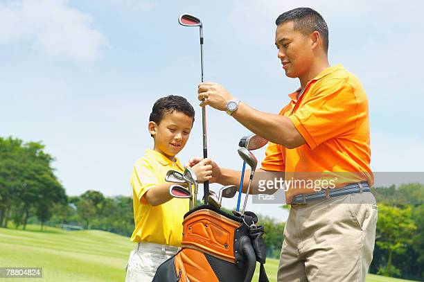Father Teaching Son to Golf