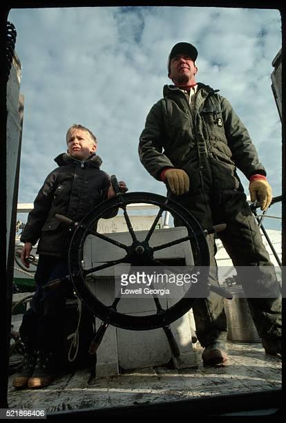 Father Teaching Son to Sail