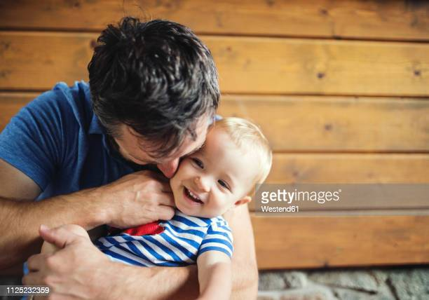 father tickling happy baby girl - tickling stock pictures, royalty-free photos & images
