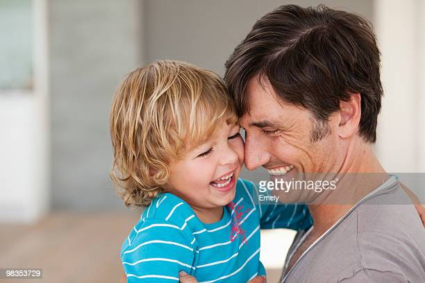 father tickling son