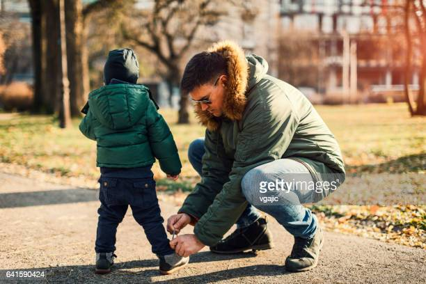 Father tied shoelace to his son