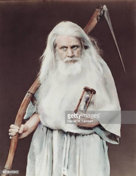 father time holding scythe and hourglass - father time stock photos and pictures