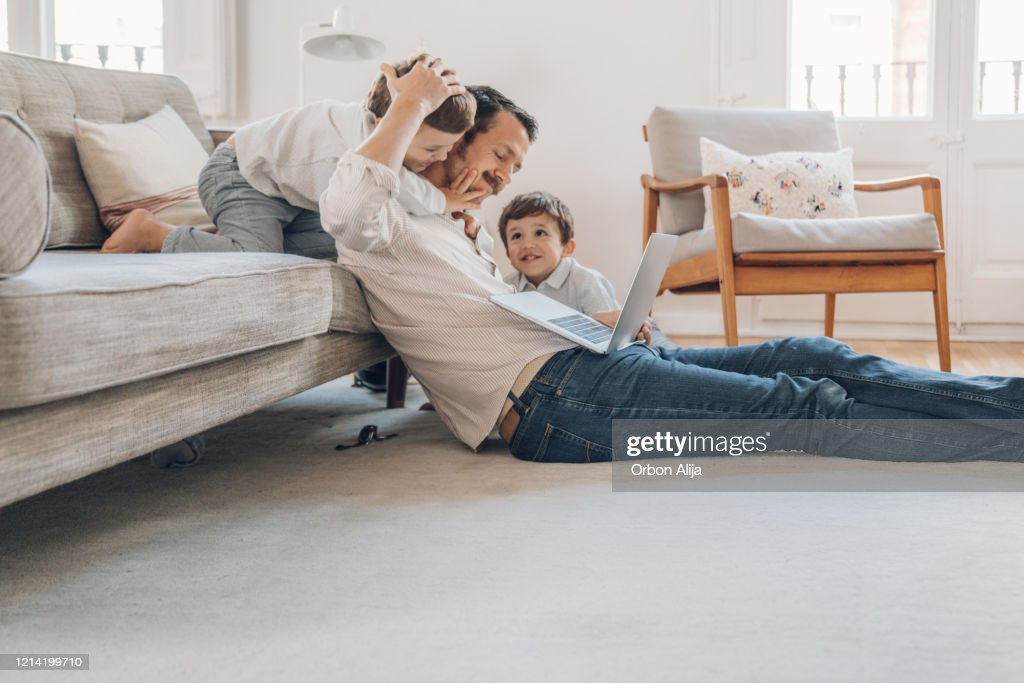 Father trying to work from home : Stock Photo