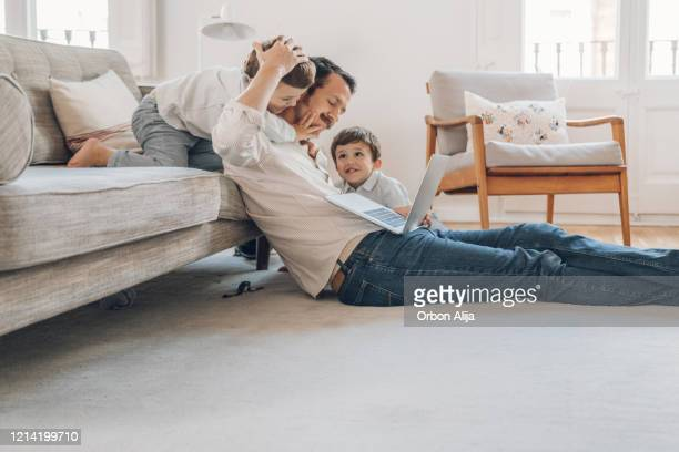 father trying to work from home - home interior stock pictures, royalty-free photos & images