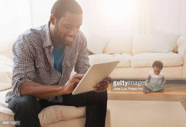 Father using digital tablet