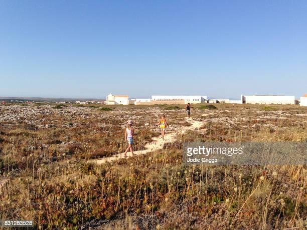 father walking with children around the sagres fortress - sagres bildbanksfoton och bilder