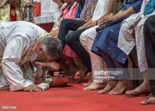 Father washes legs of 12 people as a part of Maundy Thursday celebration at Mount Carmel Church on March 29 2018 in Mumbai India Maundy Thursday is...