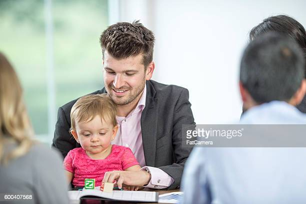 Father Watching His Daughter While at Work