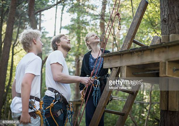 father with 2 children on canopy tour - treetop stock photos and pictures