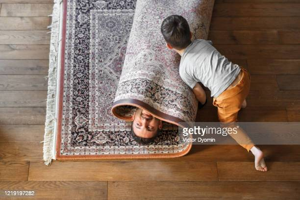 a father with a little son having fun together - opgerold samenstelling stockfoto's en -beelden