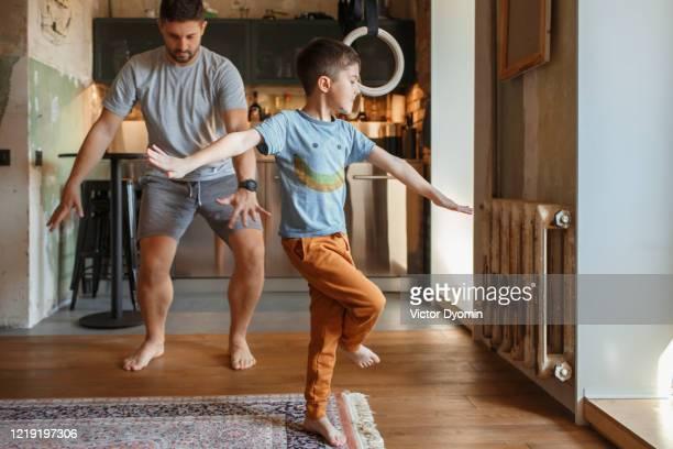 a father with a little son having fun together - tipo di danza foto e immagini stock